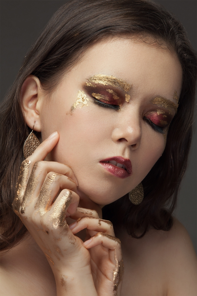 Gold leaf metallic makeup look with red smokey eyes by Yue Qi Makeup Artistry